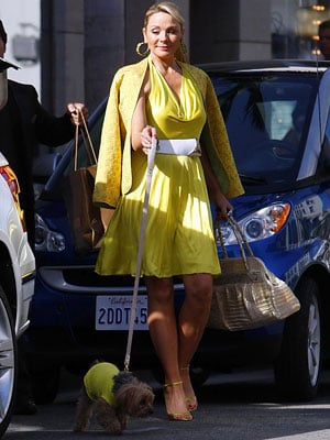 Even her dog matches her yellow outfit — surprised?