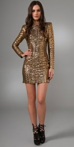 """I love everything about this dress. I would pair it with black tights, heels, and a major cocktail ring.""  Torn by Ronny Kobo Bella Pleated Metallic Dress ($385)"