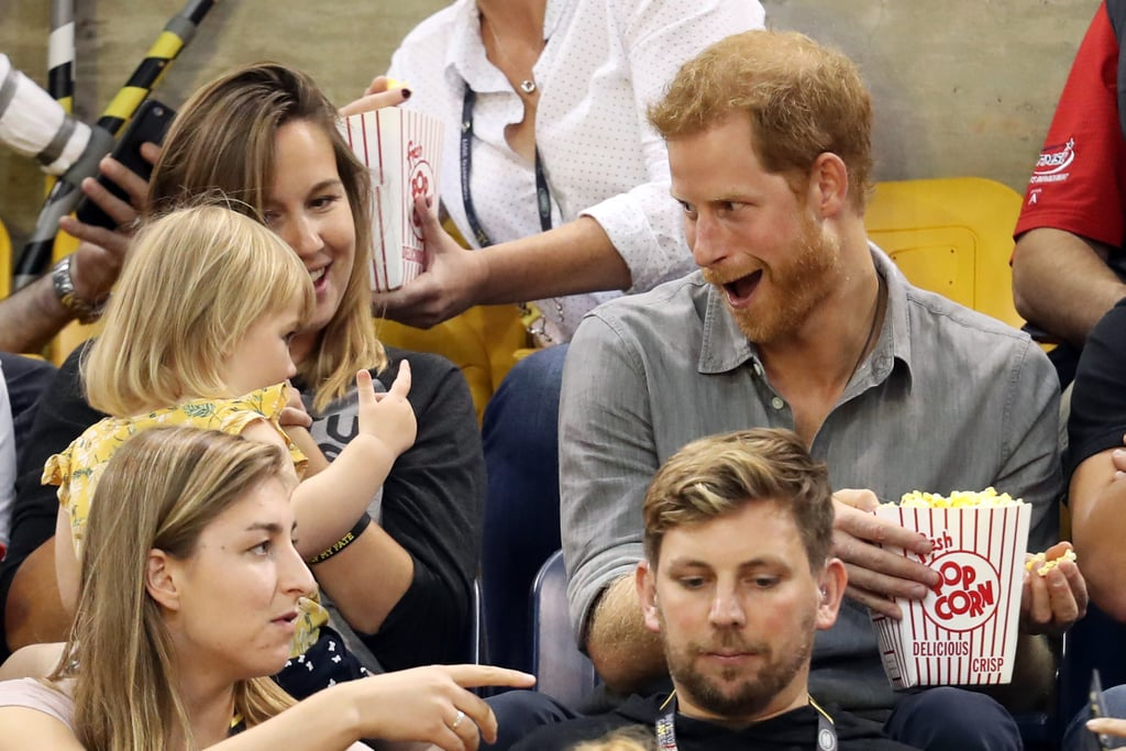 Sorry, Meghan Markle, but Prince Harry's interaction with this little girl might be our favorite part of the Invictus Games. After making his public debut with the Suits actress at the games earlier this month, the famous royal had a precious encounter with a young girl named Emily during the sitting volleyball finals on Wednesday. As Harry chatted with her parents, Hayley and David Henson, a paralympic athlete who previously competed in the Invictus Games, the toddler sneakingly stole some of his popcorn. Of course Harry, being the fun-loving guy that he is, proceeded to make a few adorable faces as he pulled away his bucket of snacks. Seriously, it's almost too cute for words.       Related:                                                                                                           38 Times Prince Harry Was Out-of-Control Cute With Kids