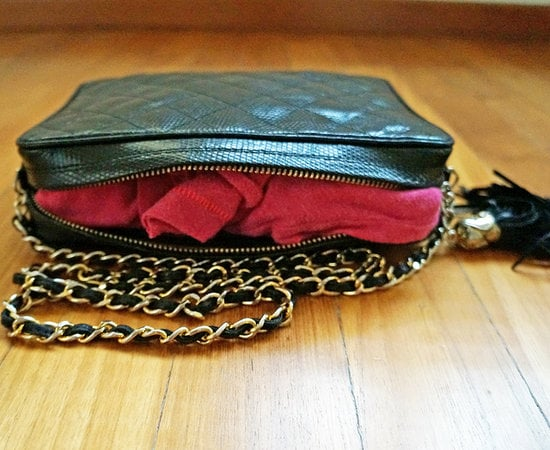 Stuff clothing into purses.