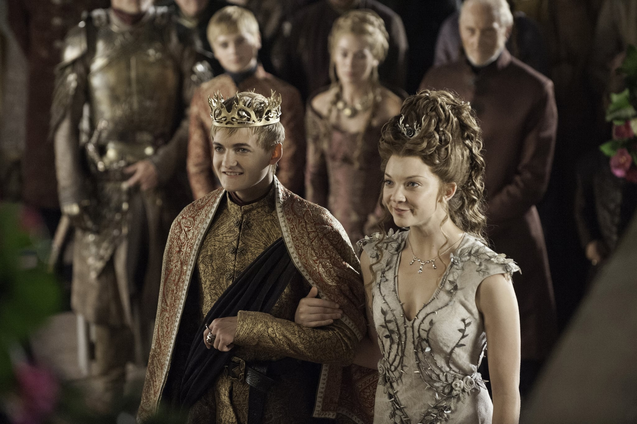 Bride Margaery and groom Joffrey stand at the altar.