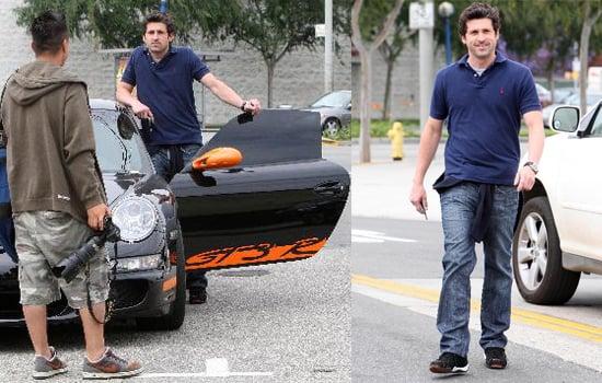 Patrick Dempsey Looks at a Jaguar Convertible