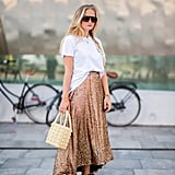 Half-tuck a t-shirt into a maxi skirt, and finish with a beaded bag and slides for easy chic.