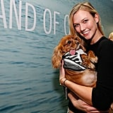 Karlie Kloss cuddled up to an adorable dog at the opening of the Band of Outsiders store in NYC's SoHo district on Tuesday.