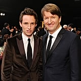 Eddie Redmayne suited up next to Tom Hooper.