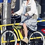 Christa Miller rode a bike on the beach.