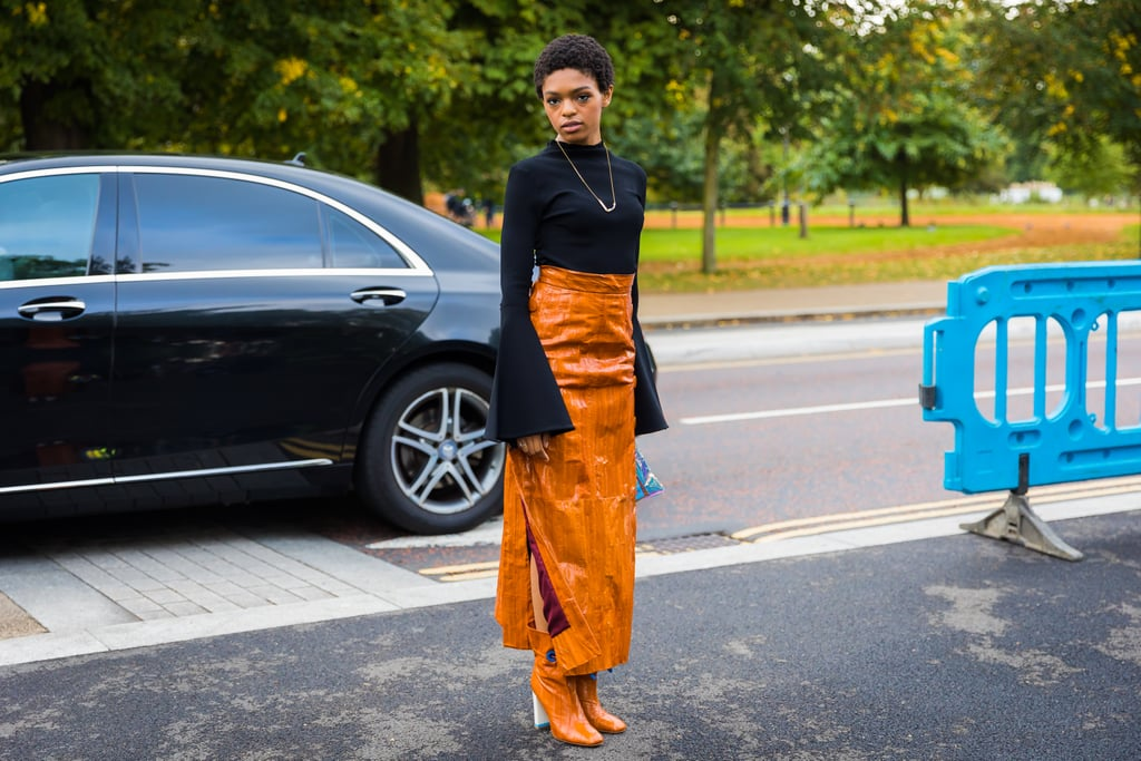 Just like you'd wear black boots with a black skirt, why not do the same but with orange? This style star kept things basic on top, but colourful on the bottom.