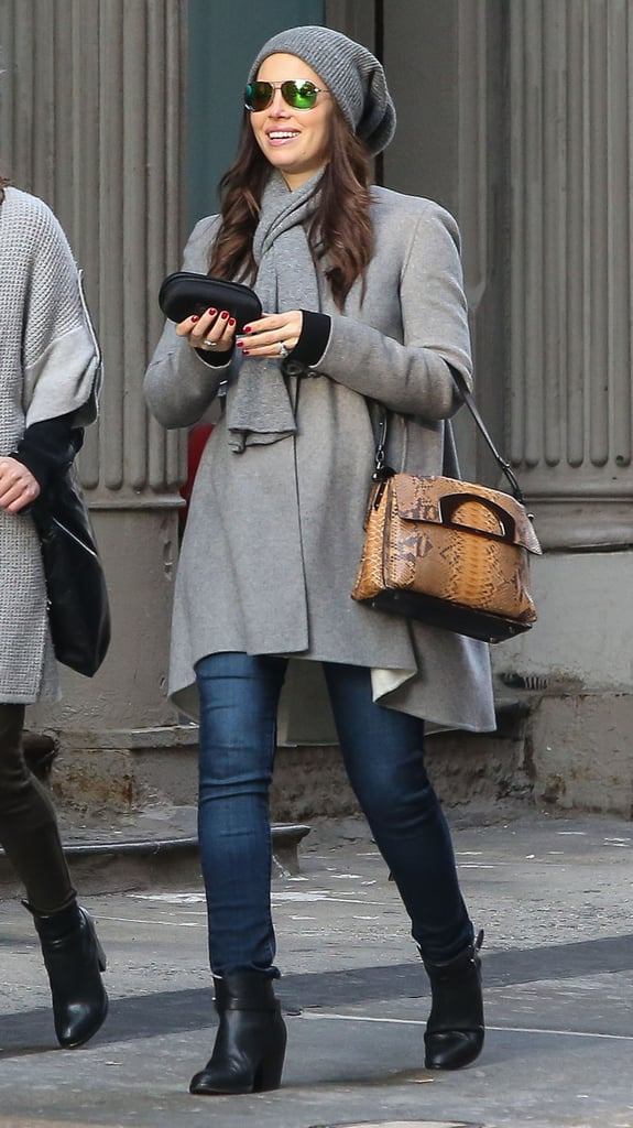 Jessica Biel kept things covered on Saturday when she caught a flight out of LA. The actress masked her rumored baby bump in a flowing gray jacket, but that hasn't stopped people from speculating about her possible pregnancy, which was somewhat confirmed when Joey Fatone publicly talked about the news. Jessica later landed in New York and on Tuesday stepped out with a friend wearing the same gray jacket as she donned during her travels. Now Jessica is on the East Coast where her husband, Justin Timberlake, played a concert in Brooklyn on Sunday. Justin reunited with Jay Z on stage during the show, and Taylor Swift and Beyoncé were spotted dancing together in the audience.