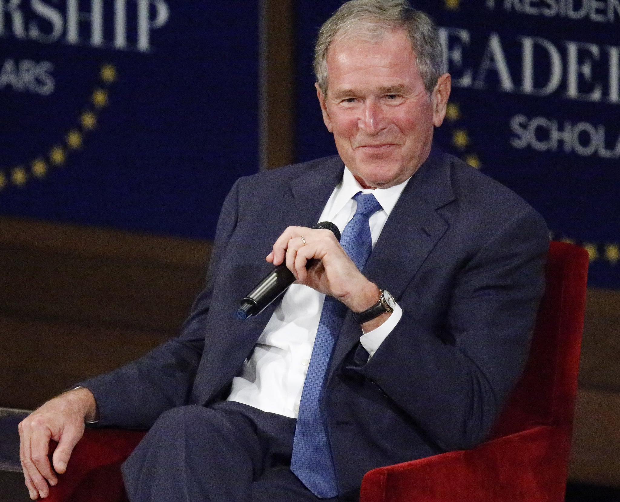 DALLAS, TX - JULY 13: Former U.S. President George W. Bush responds with a smile after making a joke while answering a question at the Presidential Leadership Scholars graduation ceremony at the George W. Bush Institute on July 13, 2017 in Dallas, Texas. The organization brings together leaders from non-profits, the military and public and private sectors for programs in leadership.  (Photo by Stewart  F. House/Getty Images)