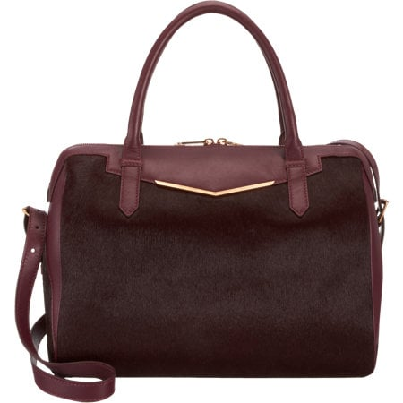 If you're looking to invest in a gift for Mom, we're betting she won't be able to resist the rich color or texture of this Reece Hudson Calf Hair Medium Bowery Duffel ($995).