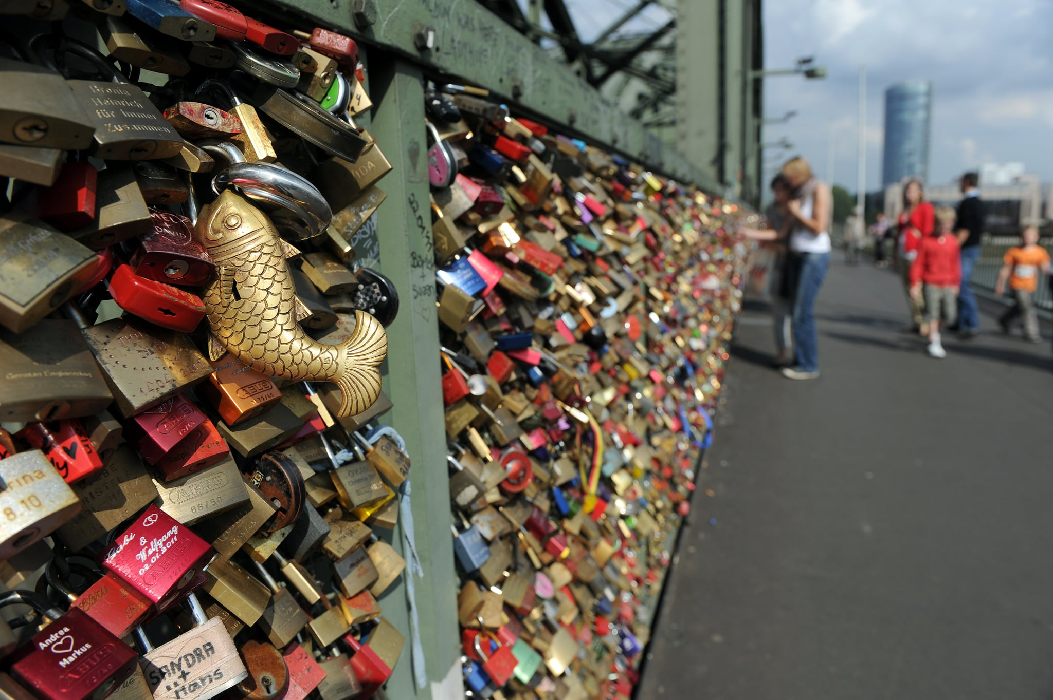 People looked at the Liebesschloesser, or love padlocks, attached to a fence on Hohenzollernbruecke bridge in Cologne, Germany.