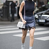 Aimee Song paired leather with leather in her boots and a navy lace skirt.