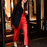 A wide belt worn high at the waist, pointed-toe stilettos, and a classic overcoat and she's out the door.