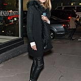While out on day three, Olivia bundled up but stayed sleek in leather pants and black booties.