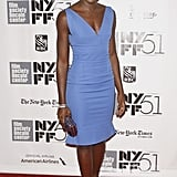 Lupita experimented with colour — and we're so glad she did — via a blue v-neck, knee-length dress at the 51st New York Film Festival. It matches her beautifully.