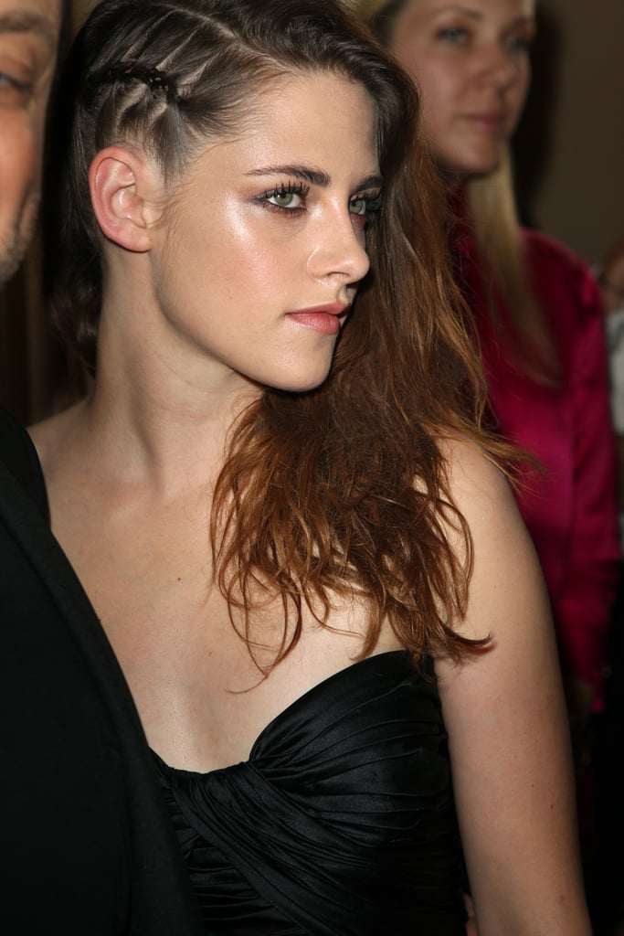 The one-sided sweep is Kristen Stewart's signature hairstyle, but she added a braid on one side for an edgier feel.