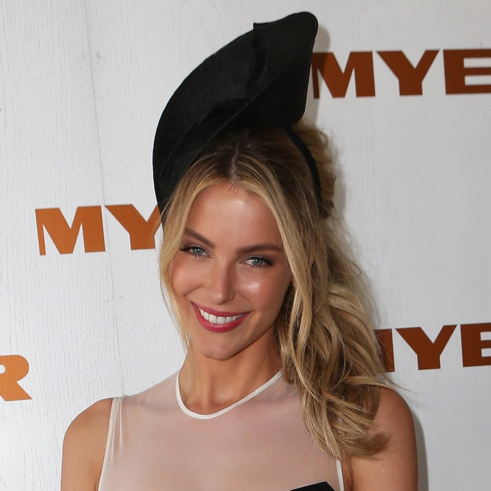 Pulled back and capped off with a quirky hat at Derby Day in November.
