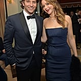Costars Bradley Cooper and Jennifer Lawrence stopped for a snap inside the Weinstein Company afterparty.