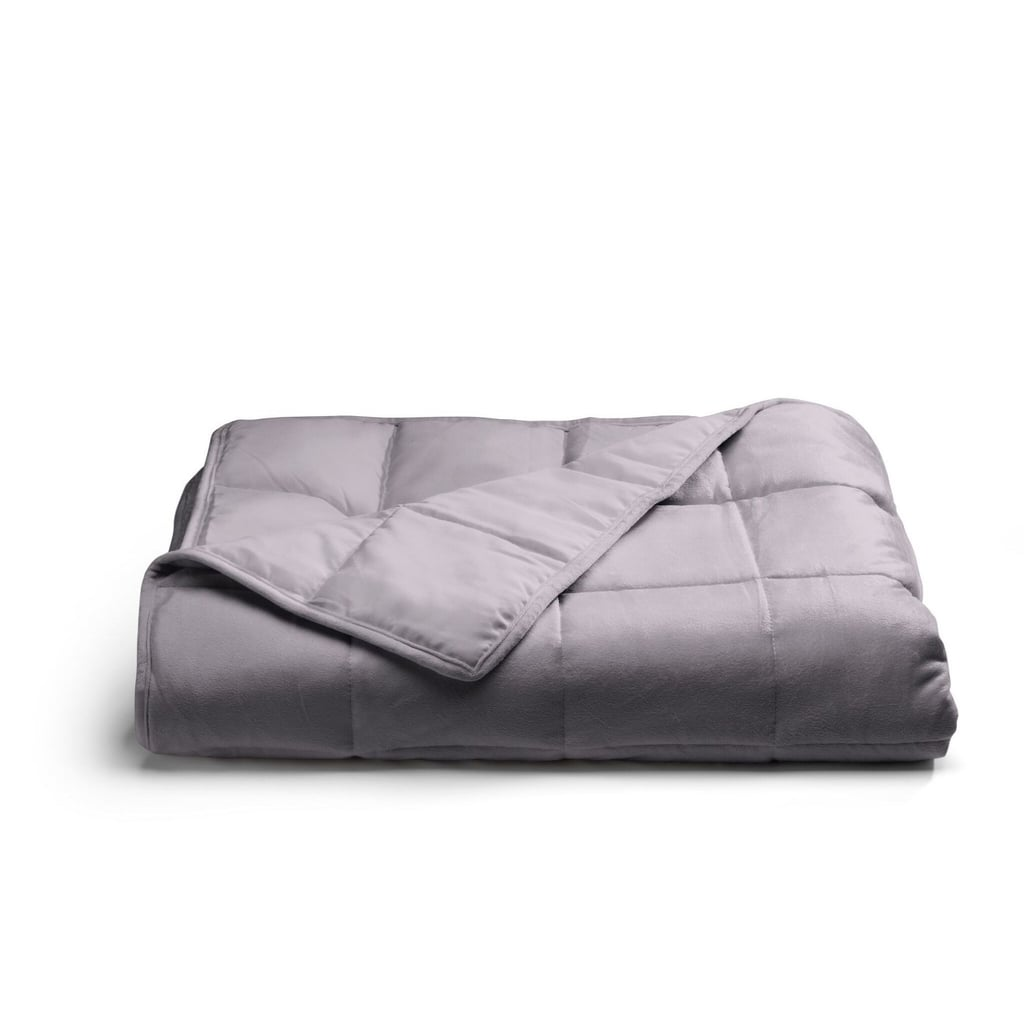 If you have family members who struggle with anxiety, then you're probably well aware that, depending on what triggers them, it can feel particularly challenging during the evenings. There are a number of ways we can all work to reduce our anxiety, and in addition to behavioral changes, things like weighted blankets have been shown to help. For starters, they can reduce stress, increase levels of oxytocin in the brain, and even help people with sensory processing disorders feel more relaxed.  And while we all want the family to get the best night's sleep, the weighted blankets on the market have been a little pricey. Now, Target is selling a more affordable version — the Tranquility Weighted Blanket ($70) — and we're definitely going to need one.  The Tranquility Weighted Blanket comes in two weights (12 or 18 pounds) and two colors (gray and ivory). While this product can be used by anyone in the family, it's important to ensure the weight is appropriate if you're going to use it for your older kids (experts suggest the blankets should roughly weigh about 10 percent of your bodyweight). Scroll through to get a look at this life-changing product.      Related:                                                                                                           Don't Overlook This 1 Thing That Might Help Kids Finally Sleep Better