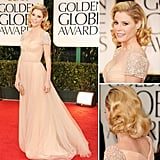 Modern Family's Julie Bowen wore a romantic, youthful Reem Acra gown with beaded cap sleeves.