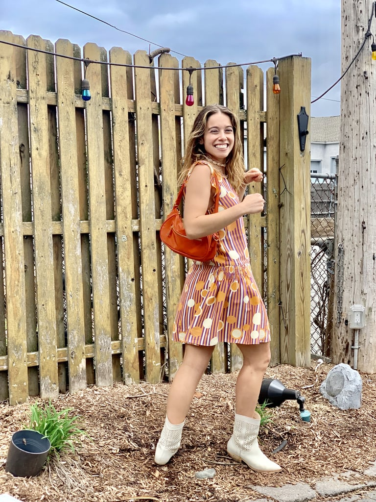 I just picked up this '90s shoulder bag from Topshop, and it instantly reminded me of Jenna's purse in the movie. I wore it with a quirky, colorful Marc Jacobs dress, but I added Western influence with my Dolce Vita boots. As far as jewelry goes, Jenna might love butterflies, but I'm a fan of shells.