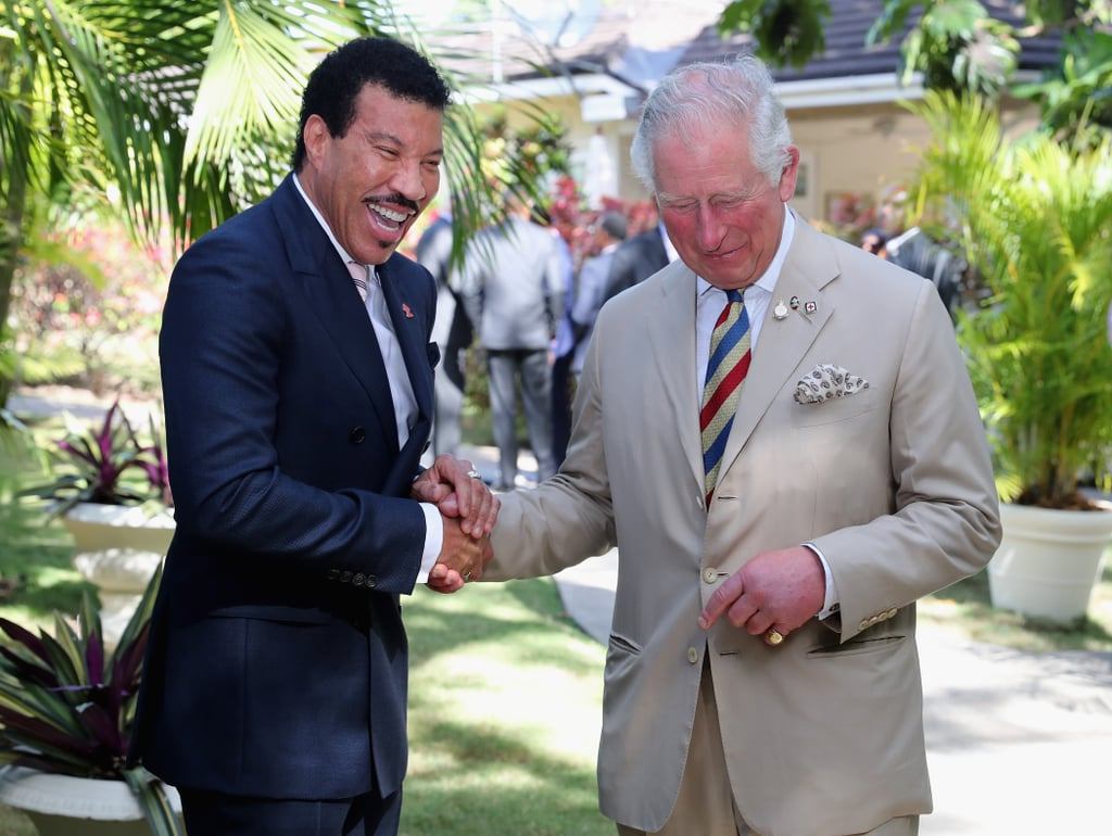 "Prince Charles continued to live the tough life of a British royal on March 19, when he hosted a reception for the Prince's Trust at the Coral Reef Club Hotel in Barbados. He and the Duchess of Cornwall are currently on a royal tour of the Caribbean, and they seem to be having the time of their lives — they even managed to squeeze in a trip to the beach during some downtime. However, on Tuesday afternoon the Prince had a very important job: to toast the first ever global ambassador to the Prince's Trust, Lionel Richie. Lionel has been involved with the Prince's Trust for a number of years, and he spoke at length at the event about the important work that the charity does with young people. Charles and Lionel definitely seemed in good spirits as they celebrated the announcement. They were pictured laughing heartily with each other, and rumour has it Prince Charles cracked a joke using the lyrics to the singer's famous hit ""Hello."" The pair also posed with Welsh singer Sir Tom Jones, who was also a guest at the reception. Keep reading to see the Prince and his new ""employee"" crack up, plus plenty more photos from the event."