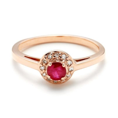 If you're girlie, you love pink, and you can't resist something totally vintage looking, this Anna Sheffield tiny round rosette ring ($1,750) is your answer.