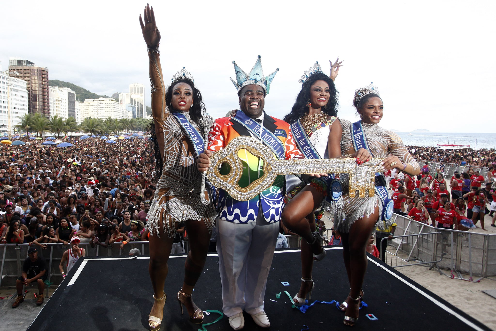 RIO DE JANEIRO, BRAZIL - JANUARY 12: Djeferson Mendes da Silva, King Momo elected and Camila Aparecida da Silva, Rio Carnival Queen elected (in the center) receive the Key of the city during the Crown ceremony. The city hall of Rio de Janeiro celebrated this Sunday afternoon at Copacabana beach along with