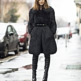 Christine Centenera bundled up in the most luxurious of jackets, then stepped into a pair of thigh-high leather boots. Source: Le 21ème   Adam Katz Sinding