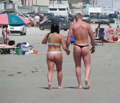 Couple Wears Matching Thongs on Beach
