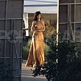 Rihanna changed into a gold dress for a shoot for Harper's Bazaar in Malibu.