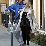 Pregnant Jessica Simpson wrapped up in a white coat on a date with Eric Johnson.
