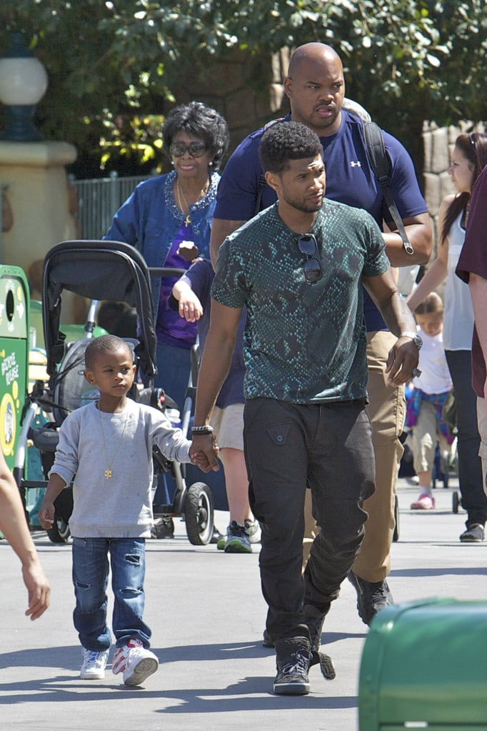"""Usher and his sons Naviyd and Cinco kicked off their Easter weekend with a visit to Disneyland on Friday. The trio were spotted checking out the park's many attractions and cooling off between rides with icy drinks. The boys seem to be taking after dad in the fashion department and were both wearing Jeremy Scott for Adidas sneakers. Not to be outdone by his mini mes, Usher also stepped up his fashion game by modeling an on-trend python printed tee from Jil Sander. Usher's currently putting the finishing touches on his seventh studio album, Looking For Myself, due out June 12, and already dropped the first single, """"Climax."""""""