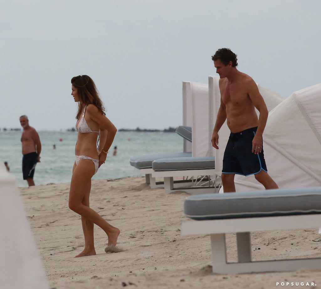 Cindy Crawford and Rande Gerber headed to the beach in Miami for a quick dip on Monday. Cindy, who turns 50 in February, and 53-year-old Rande wasted no time taking off their tops to head to the water. They recently arrived in Florida to continue Cindy's book tour; her memoir, Becoming, was released in September and she already made a stop in London to promote the project. In addition to her husband of 17 years, Cindy had the support of longtime pal George Clooney during her overseas stop. She'll continue making the press rounds until mid-October when she has her final scheduled appearance back home in LA.