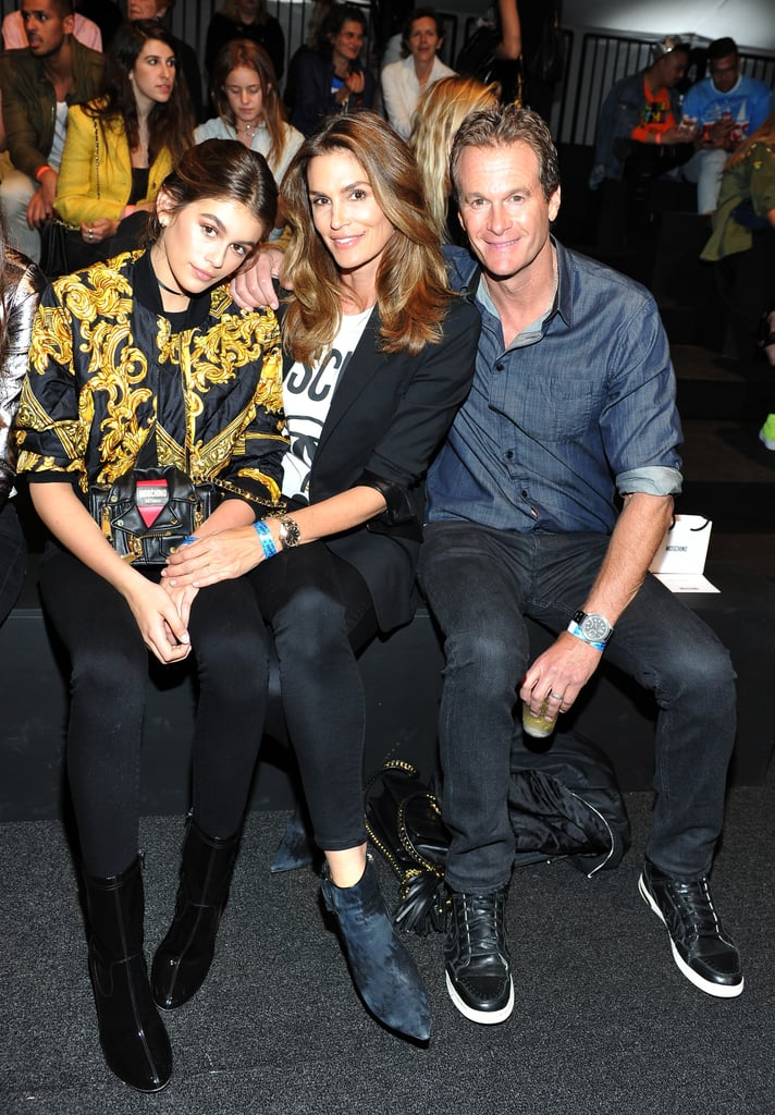 """It was a family affair at Moschino's fashion show in LA on Friday night. Presley Gerber made his catwalk debut and his family — mum Cindy Crawford, dad Rande Gerber, sister Kaia Gerber, and girlfriend Lily Moulton — was on hand to support him on his big day. The genetically blessed brood attentively took in the show from the front row and joined him and stylist Carlyne Cerf de Dudzeele for photos backstage. Prior to the show, Presley told Vogue magazine, """"Honestly, I have enjoyed [the fashion industry] a lot more than expected. I think I just didn't feel that I had enough experience in the fashion industry before, but now I believe I'm ready.""""  Later that night, Cindy took to Instagram to share a photo of her son on the catwalk, writing, """"So fun watching @PresleyGerber walk @Moschino tonight! 💚 @ItsJeremyScott #MADELA."""" Kaia also did the same, gushing, """"Proudest sister in the world rn :)."""" Keep reading to see more cute moments from their night, then get a closer look at the fabulous life of Cindy's family."""