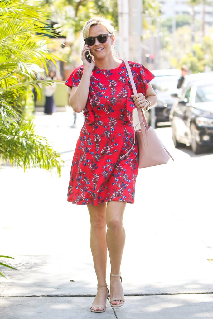 Matching her blush-hued purse with her shoes.
