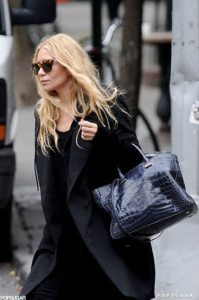 Ashley Olsen carried a navy-blue bag from The Row.