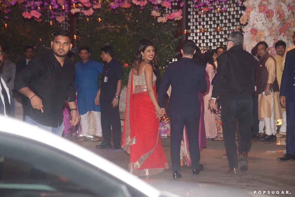 "Nick Jonas and Priyanka Chopra are feeling the love in India! After Nick reportedly met Priyanka's mom, Madhu, the couple stepped out hand in hand for pal Akash Ambani's pre-engagement party in Mumbai on Thursday. Nick looked dapper, as per usual, in a navy suit, while Priyanka stunned in a beautiful red-and-gold sari dress. The two clearly were not shy about showing PDA, as Nick wrapped his arm around Priyanka and she flashed a big smile for the cameras. Nick and Priyanka were first linked back in May, and from the looks of it, things are getting serious! Honestly, have you ever seen such a good-looking couple?      Related:                                                                                                           30 Times Priyanka Chopra and Nick Jonas Made Us Say, ""DAMN, They Look Good Together!"""