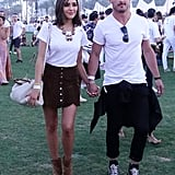 Olivia Culpo wearing a white tee, Atelier Swarovski necklace, and miniskirt at the festival.
