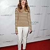 In February, Christa went laid-back in a striped long-sleeve tee and off-white jeans, finished with fabulous red gladiator-style sandals.