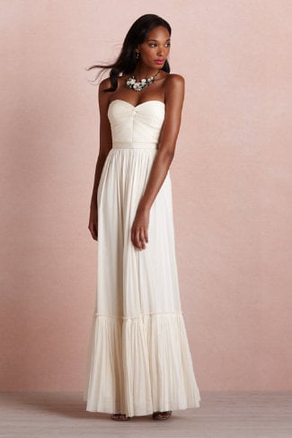 We envision this Va Et Vien sheer ivory tulle column dress ($350) working perfectly for a beachy wedding. A pair of gold flat sandals and a few simple baubles would round it out beautifully.