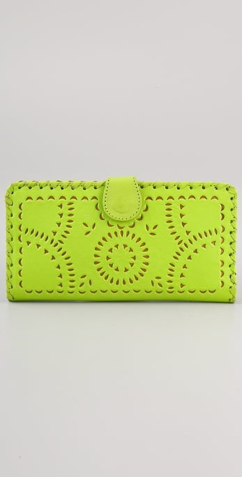 This laser-cut wallet can easily double as a chic clutch for evening.  Cleobella Mexicana Painted Mini Wallet ($110)