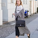 With a laid-back tee and sandals — and a cool duster that pulls it all together