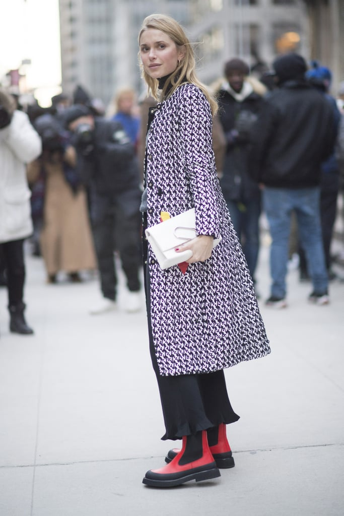 With a Patterned Jacket and Red-and-Black Boots