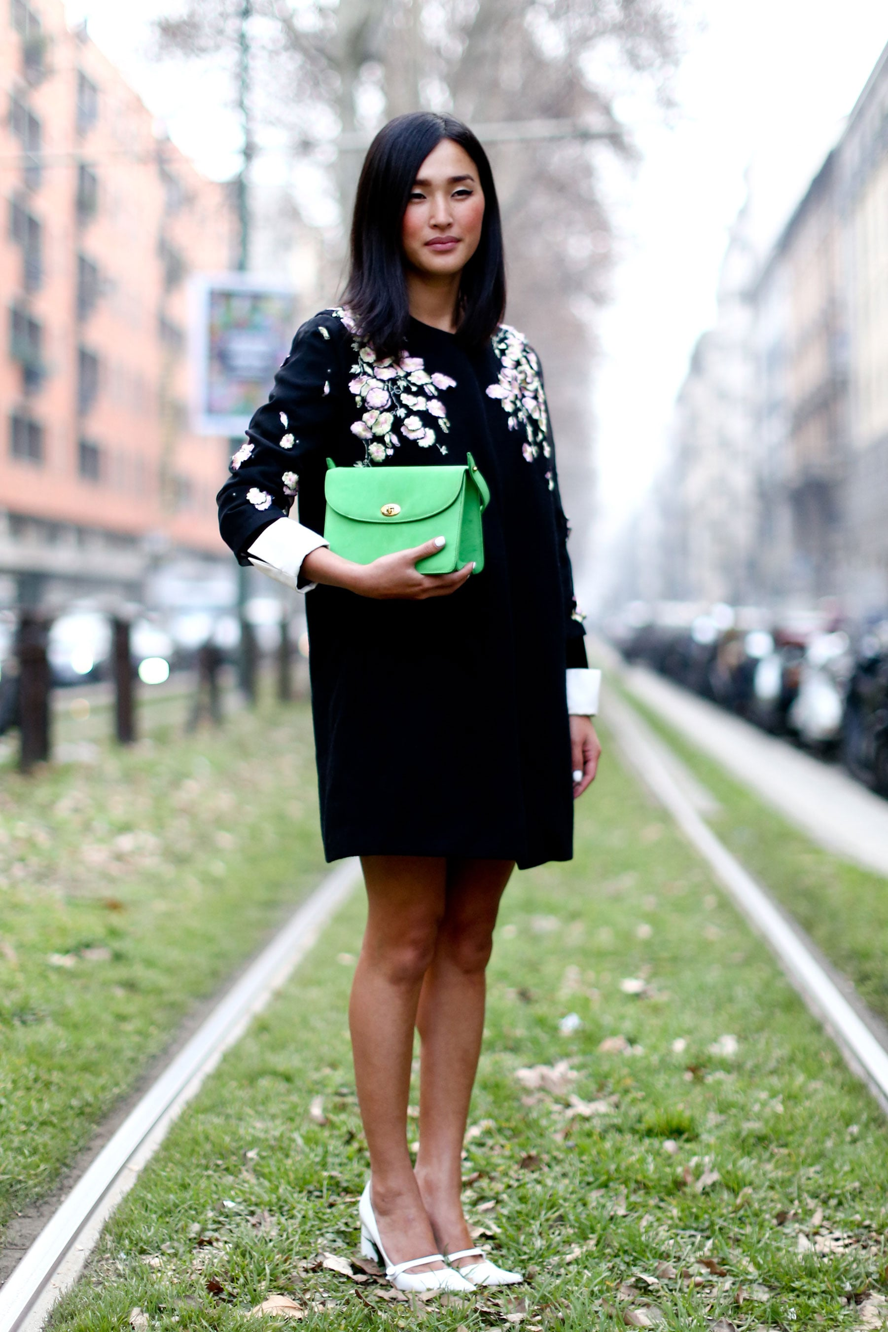 We adore the perfectly modern, minimalist take on ladylike with a boxy, bright satchel and sleek low-heeled white pumps.