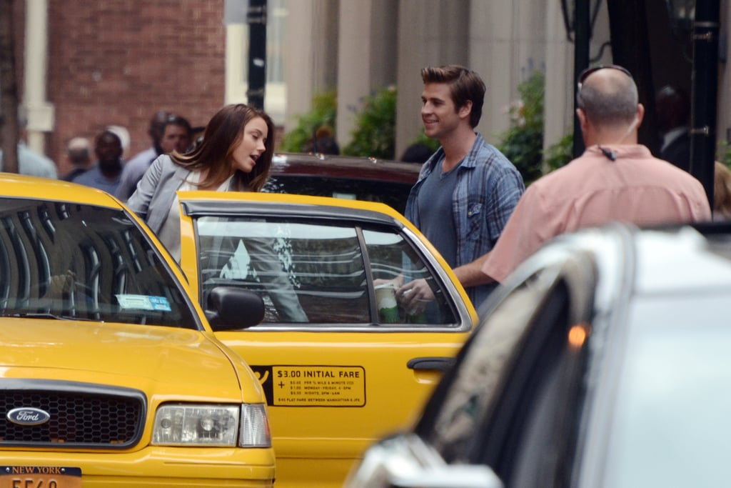 Liam Hemsworth and Amber Heard hopped into a cab on set.