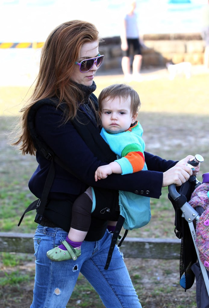 Elula Cohen was strapped to her mom Isla Fisher for a walk.