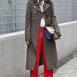 Shiona Turini made a cool-girl play on green and red in an olive military coat and bright pants.