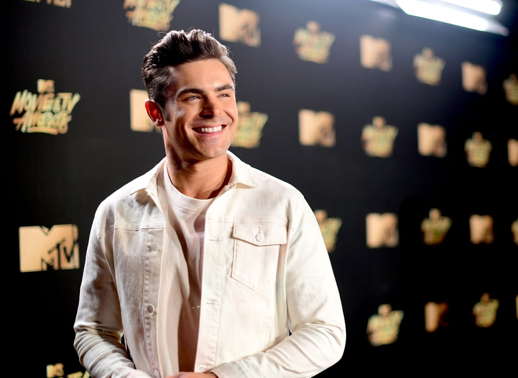 Zac Efron's MTV Movie and TV Awards outfit was quite the trendy double whammy. Not only was he rocking all white from head to toe, but the actor was also sporting denim on denim like it was his damn job. I mean, he could honestly wear a rubbish bag and we'd still be into it, but this look was definitely a hit. Zac paired a denim jacket and plain white t-shirt with slightly distressed jeans and classic white Converse, one of our go-to versatile trainer choices.  Ahead, see Zac practically leaving a trail of flames on the red carpet with his white-hot outfit.