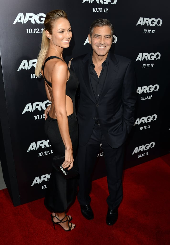 Stacy Keibler perfected her sultry Alaia look with a studded Valentino clutch.